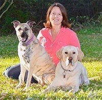 Debi at Rescue Dogs 101 with dogs Bear and Ginger
