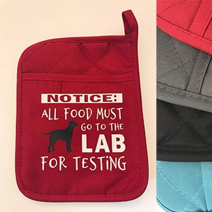 red kitchen pot holder with a dog and text that reads Notice: all food must go to the lab for testing